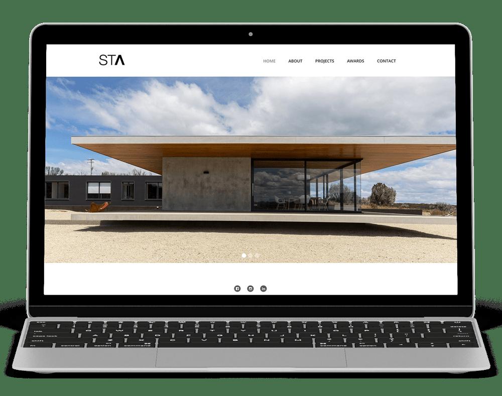 laptop showing stuart tanner architects website