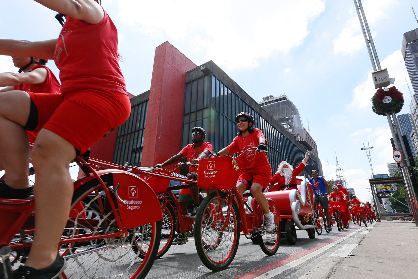 Sled driven by cyclists travels 'Christmas Illuminated' on Paulista Avenue in Sao Paulo.