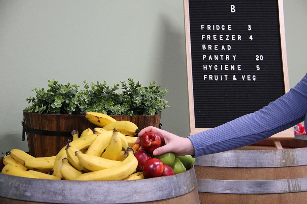client choosing fresh fruit
