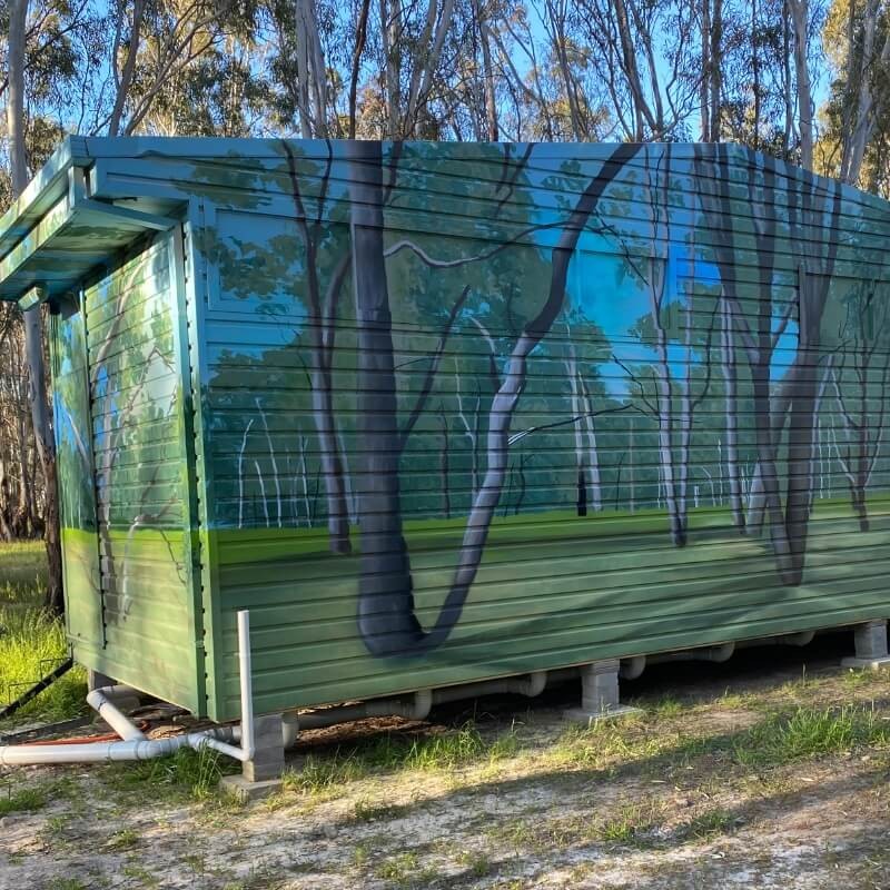 Camping facilities at Murray Life Adventures, spray painted with images of trees