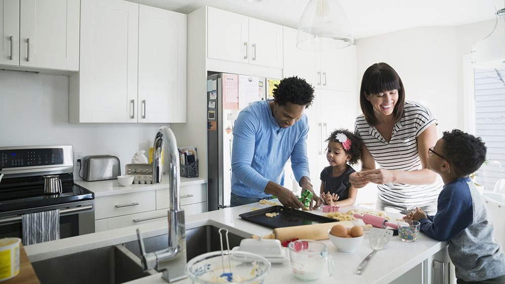 A family in the kitchen baking cookies, portraying participation at OhmConnect