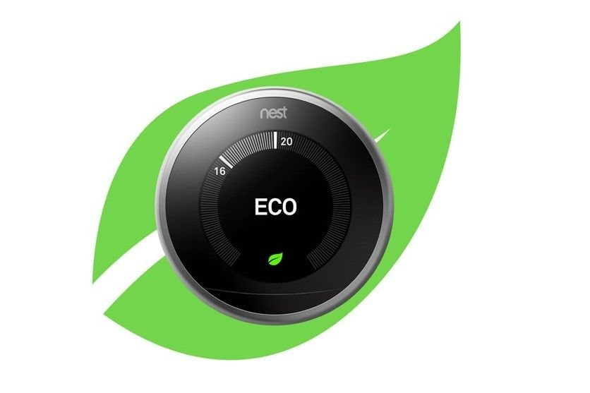 Nest learning thermostat in front of the nest leaf