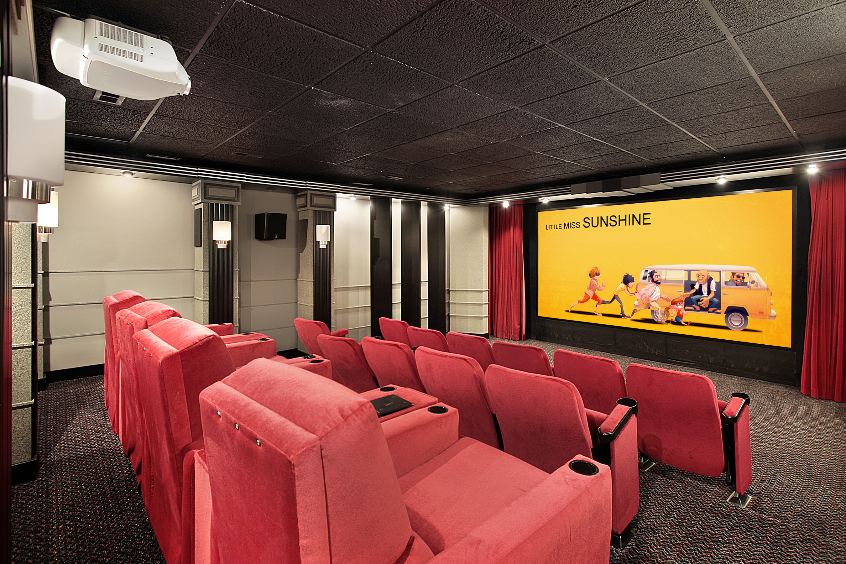 Cosy home theatre room showing off the beautiful Red velvet theatre seating with projector and screen.