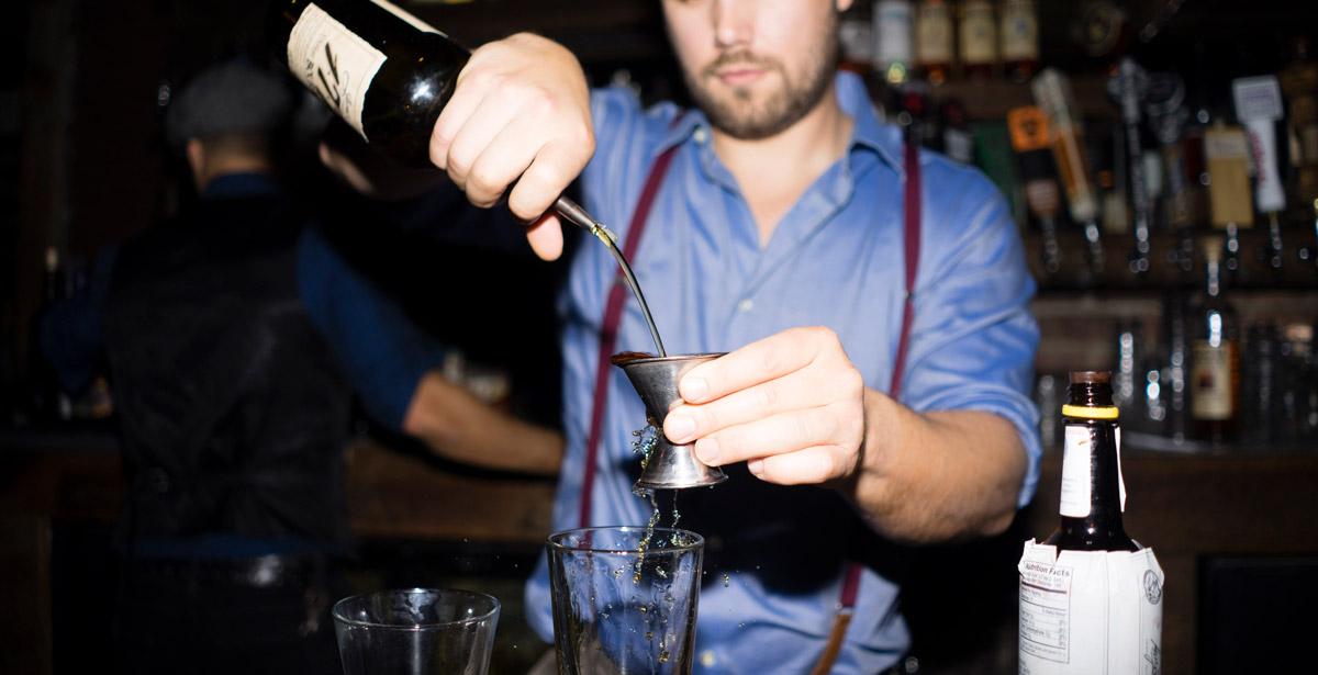 Bartender pouring a shot.