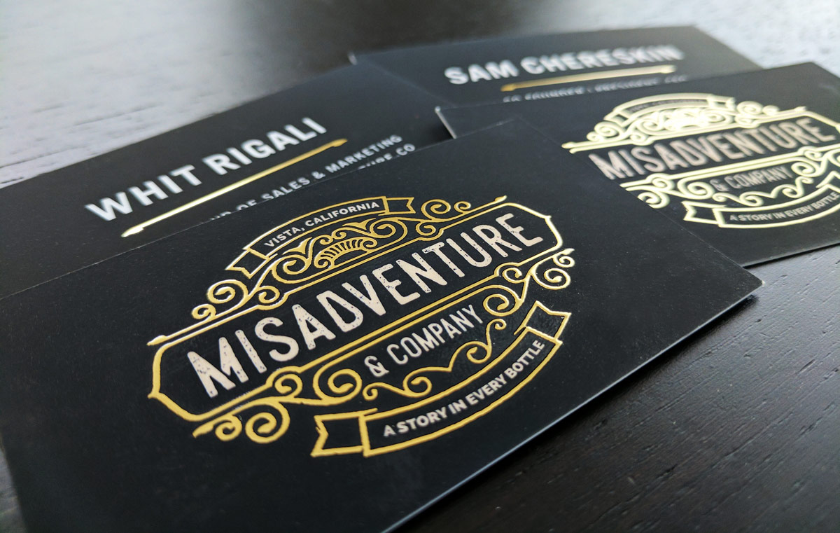 Misadventure and Company's business cards with gold foil
