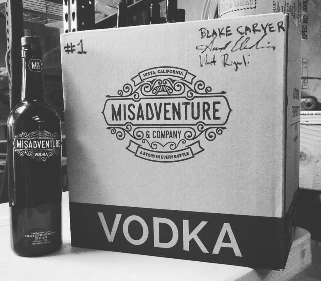 Misadventure and Company's vodka bottle and shipping box.