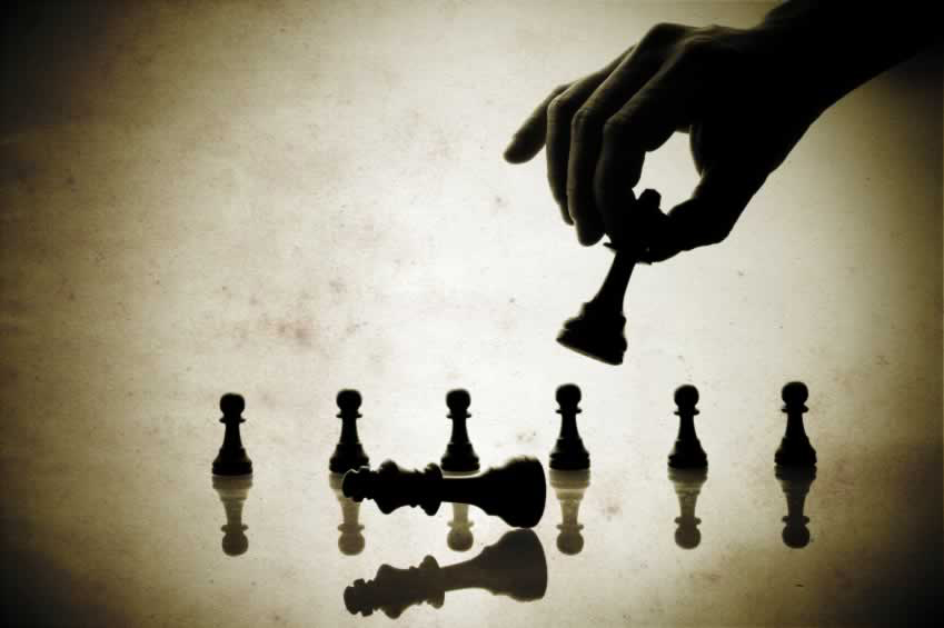 a two tone image of chess pieces being played