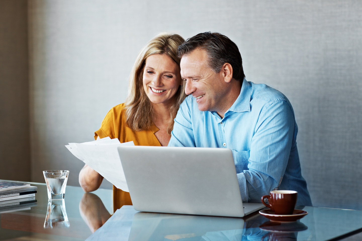 couple looking over important last will and testament and estate documents