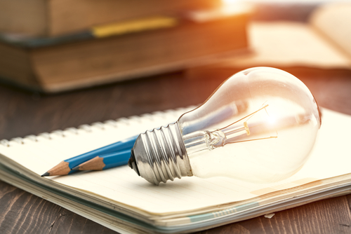 Lightbulb, pencils and a notepad - Learning ideas