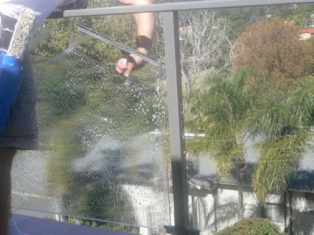 cleaning exterior side of glass balustrades