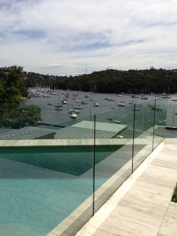 glass pool fence that needs cleaning