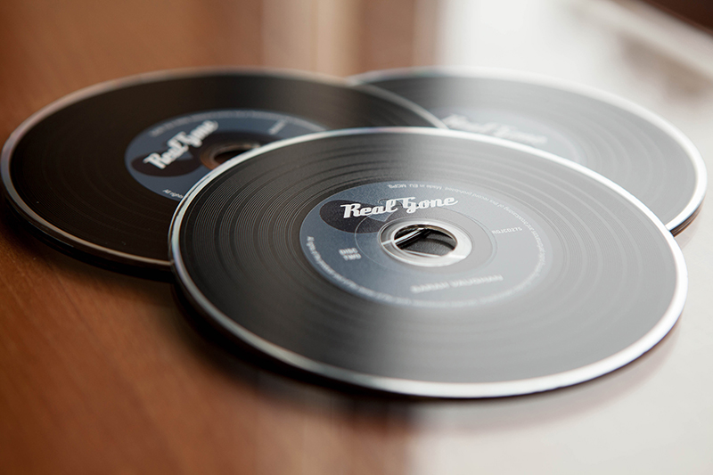 three jazz CDs laid over one another