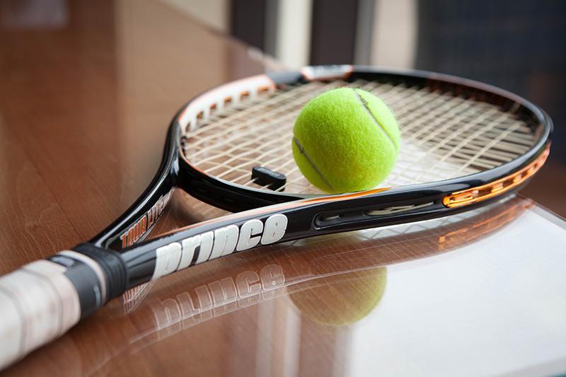 tennis ball on a tennis racquet