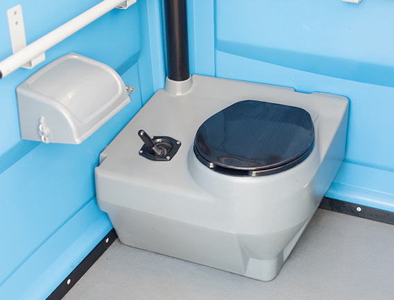 Low level toilet for wheelchair users