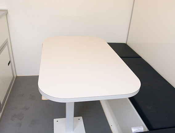 Table and bench in a mobile welfare unit