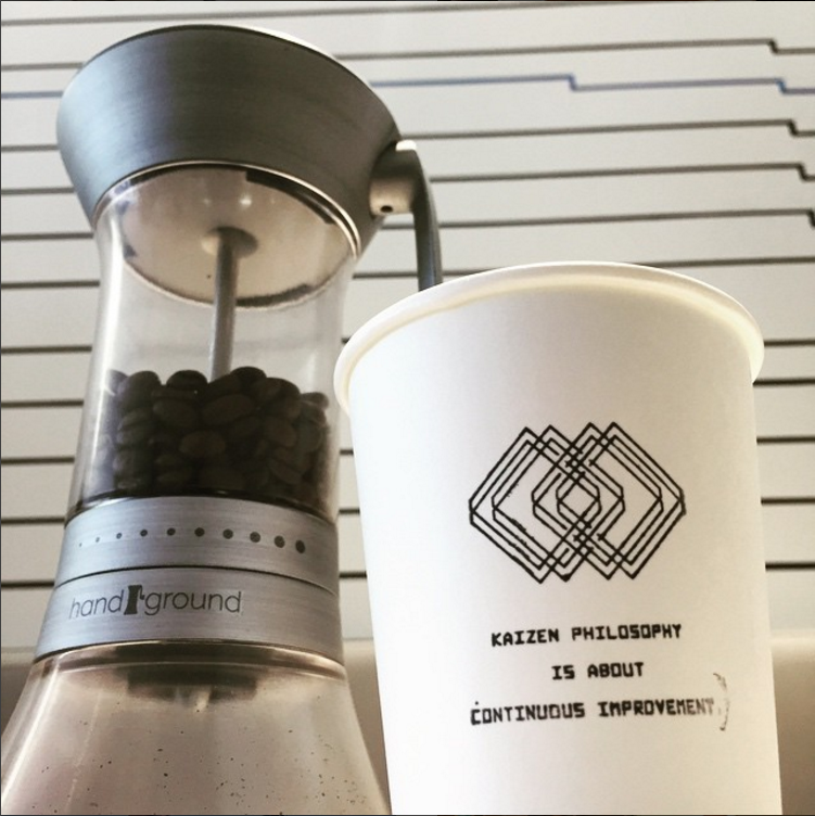 "Handground prototype with coffee cup that says ""Kaizen"""