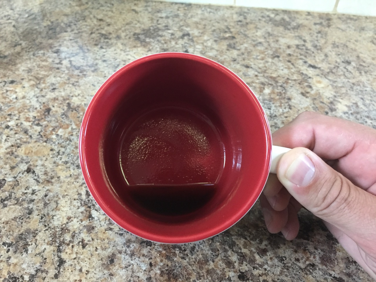 Sediment at bottom of a cup of french press coffee