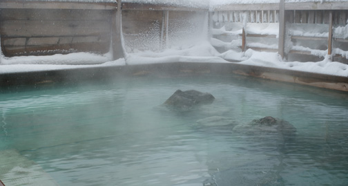 photo of an onsen in winter