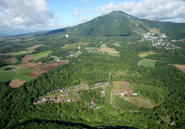 aerial photo of country resort and mt niseko
