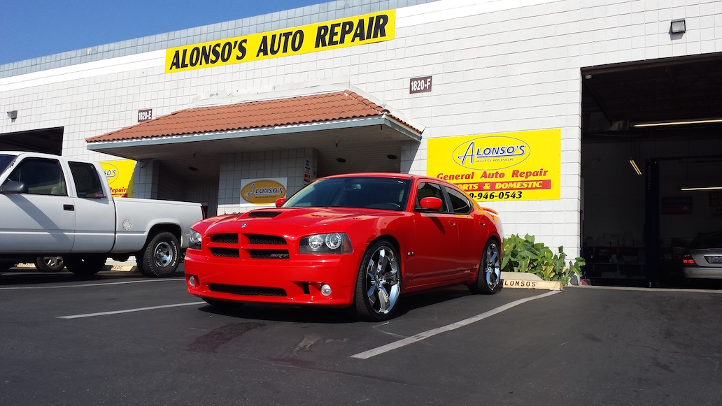 dodge charger serviced by alonso's auto repair parked by garage
