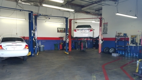 toyota camry and ford focus being serviced in the garage