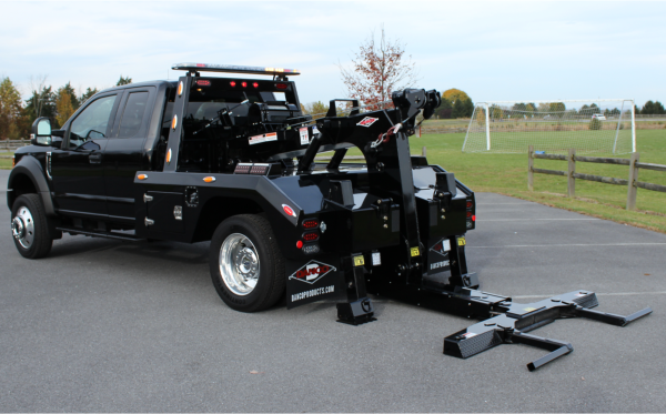 Roll Back Bodies – Action Fabrication and Truck Equipment
