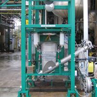 Suursäkin tyhjennys ja tuotteen annostelu aeromekaaniselle putkikolakuljettimelle