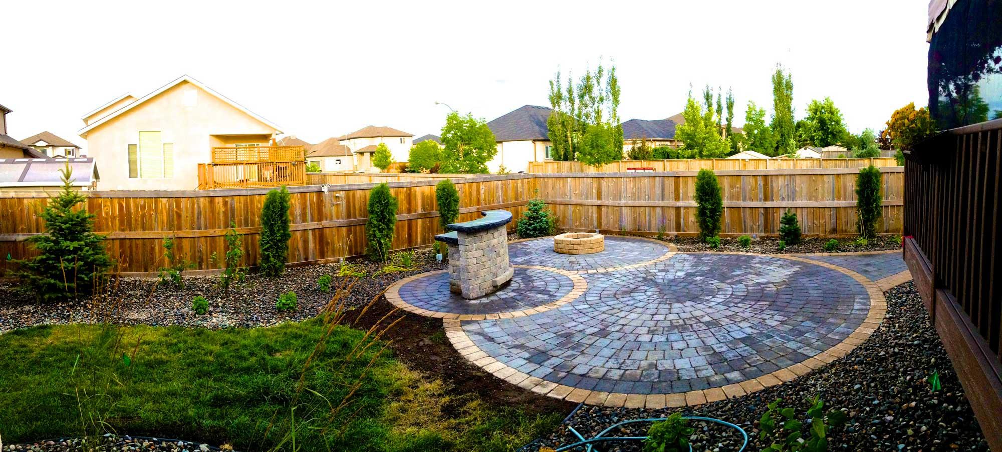 barkman roman circle patio by a winnipeg landscaping contractor