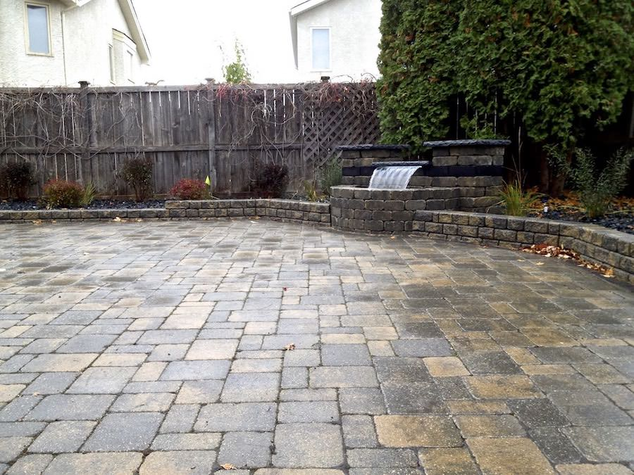 Winnipeg landscaping project roman paving stone and water fall