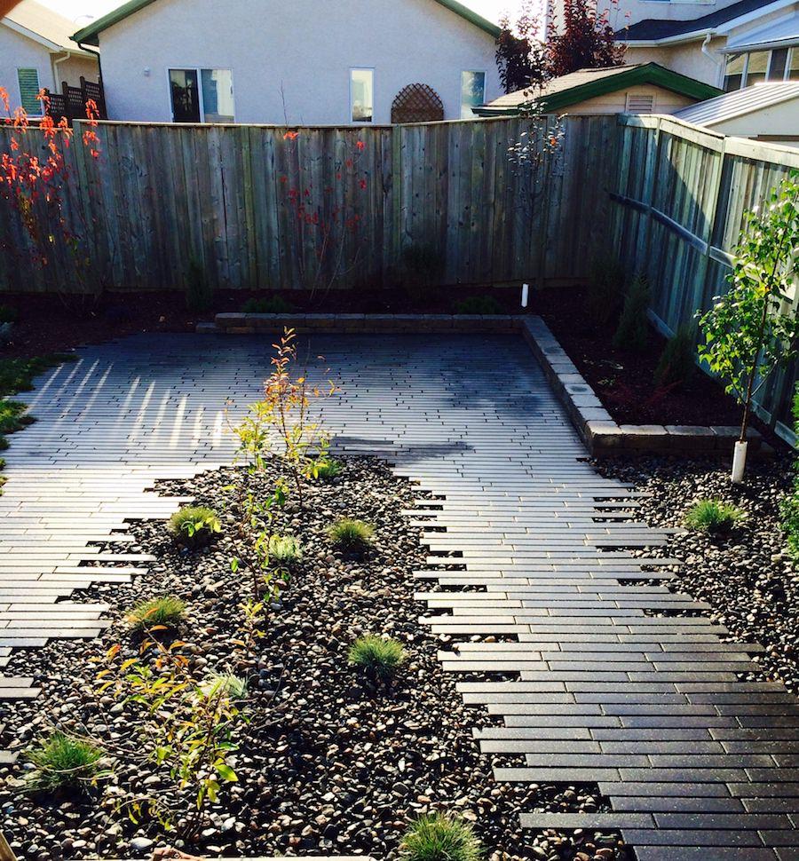 landscaping in backyard with navaro paving stone Winnipeg