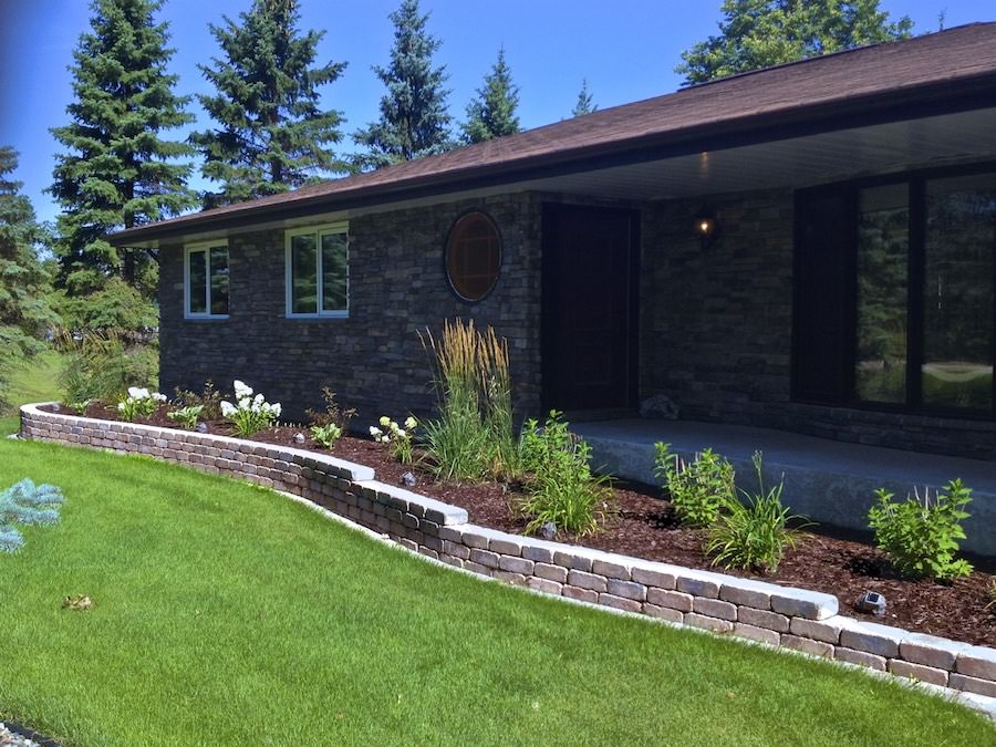 Front yard landscaping retaining wall Winnipeg Quarry stone