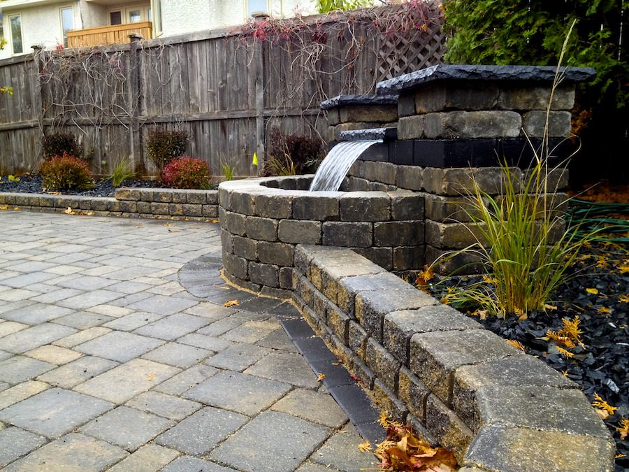 Roman stack retaining wall and water feature landscaping