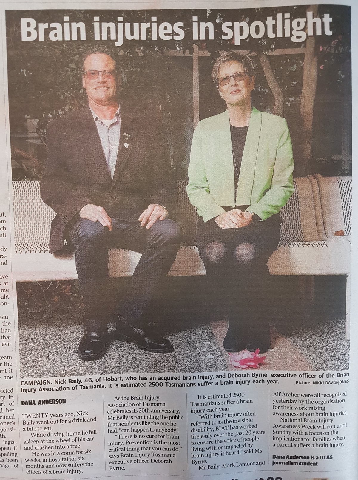 Newspaper image of Nick and Deb sitting