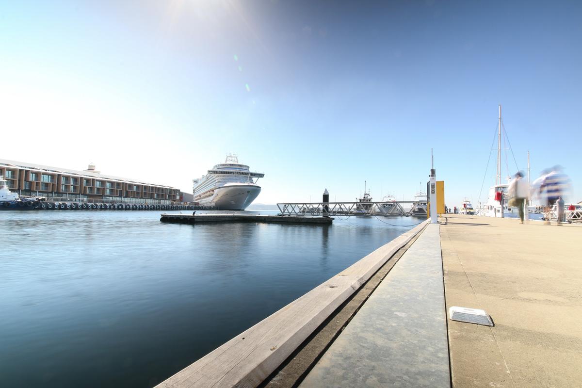 Toursits wander down the main dock.