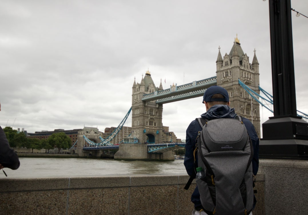 Dom taking a photo of the London Bridge in the jacket