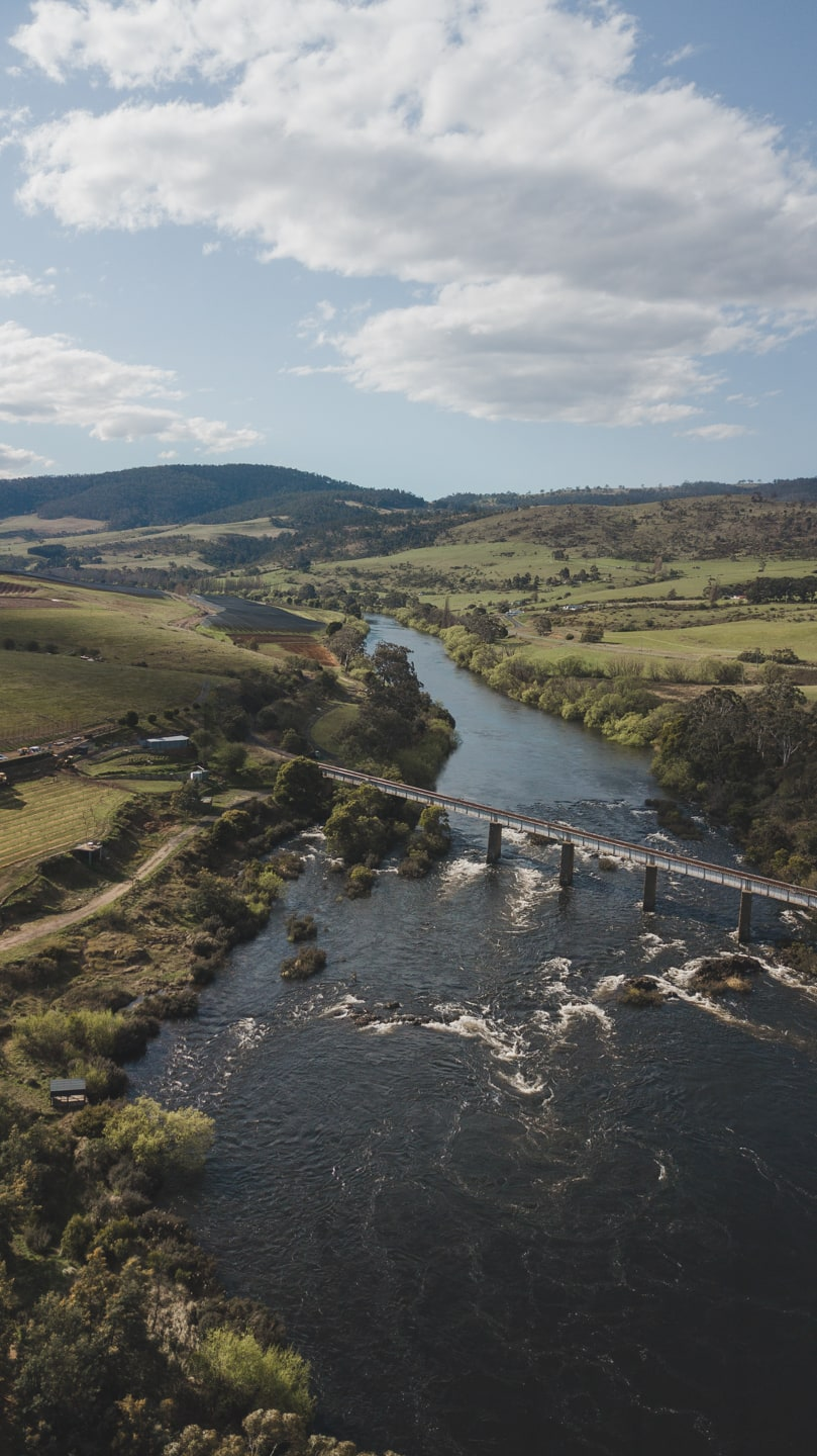 drone shot over a bridge and water in tasmania