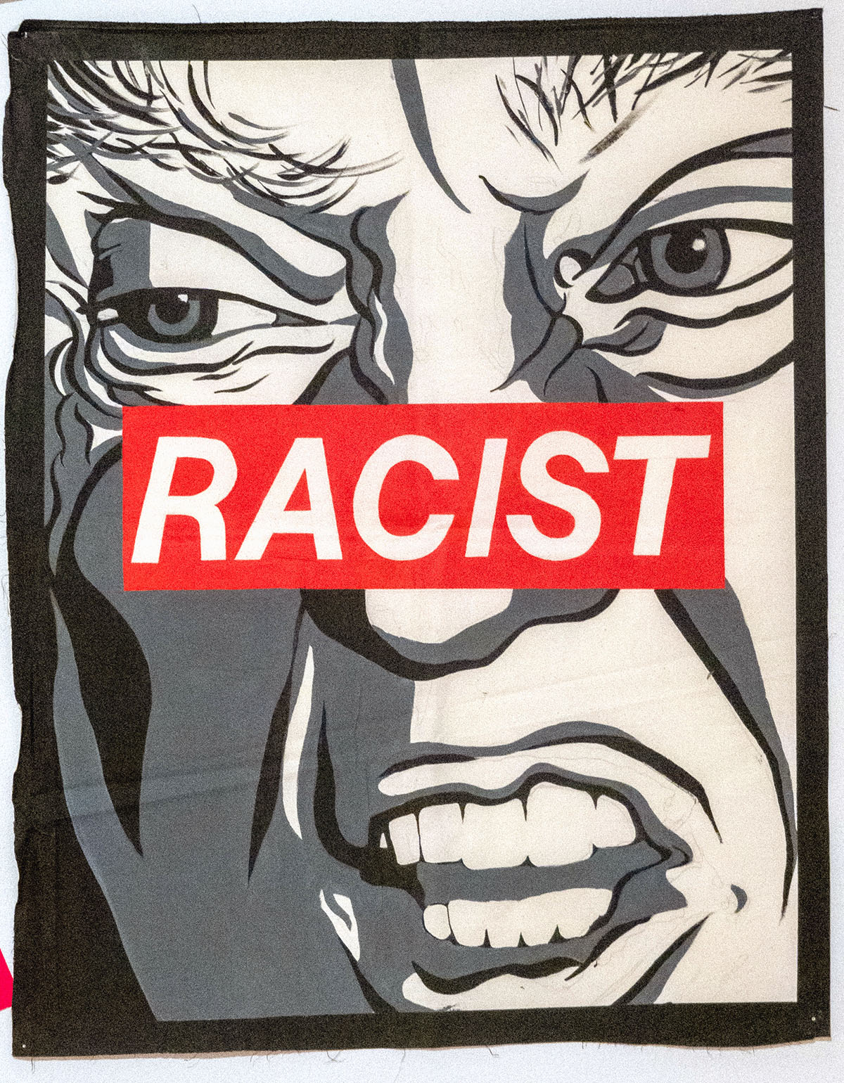 Racist portrait of Trump in the style of Barbara Kruger
