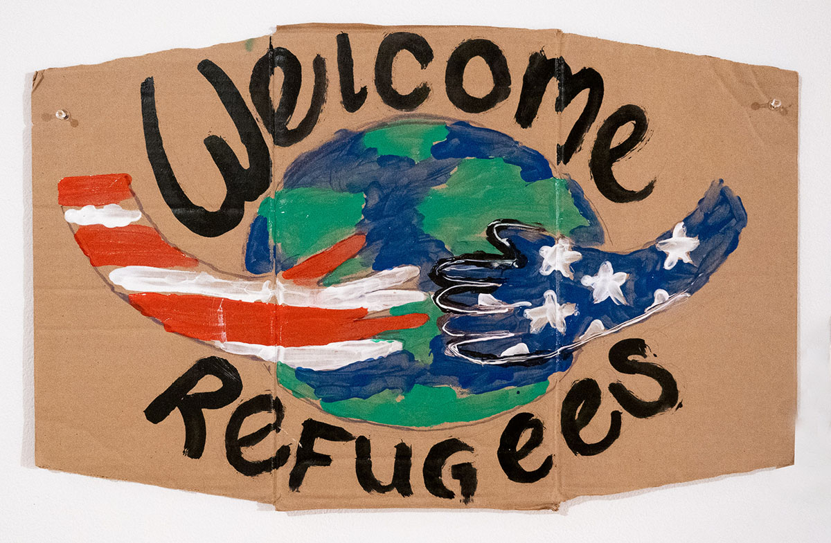 Welcome Refugees (hands holding earth)