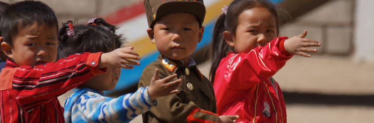 children saluting in north korea military