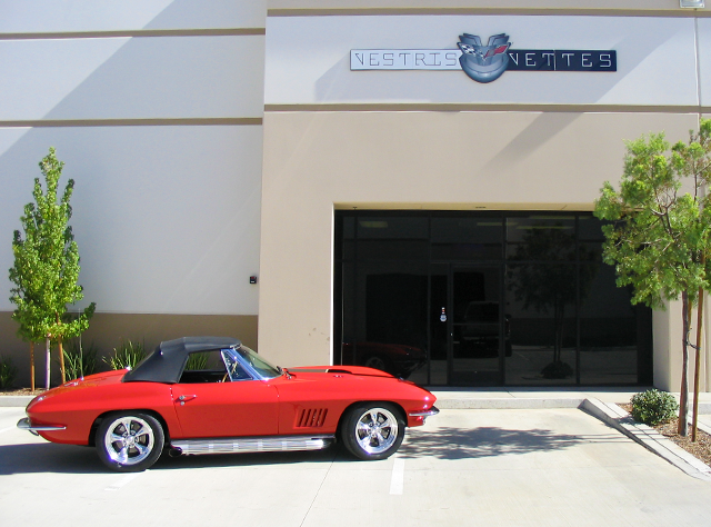 1967 convertible red with black stinger and LS7 motor  in front of shop