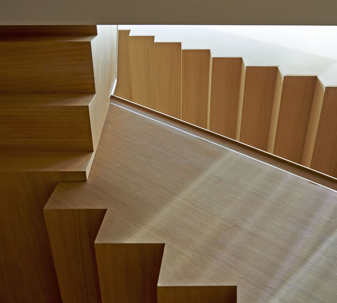 wood stair, custom stain, elegantly crafted stair, self supporting stair