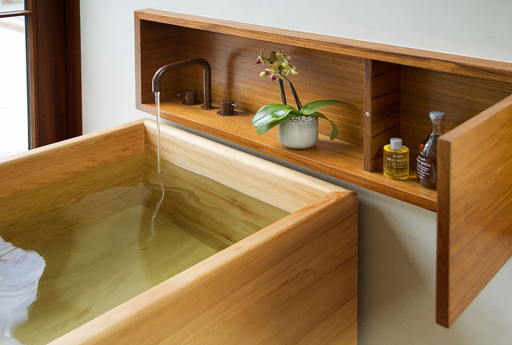 Wooden soaking tub, teak cabinetry