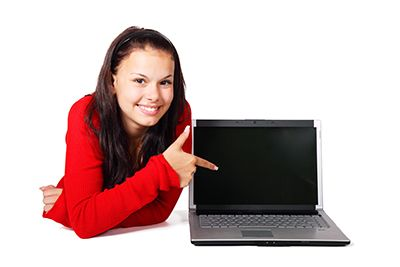 Girl pointing at a computer