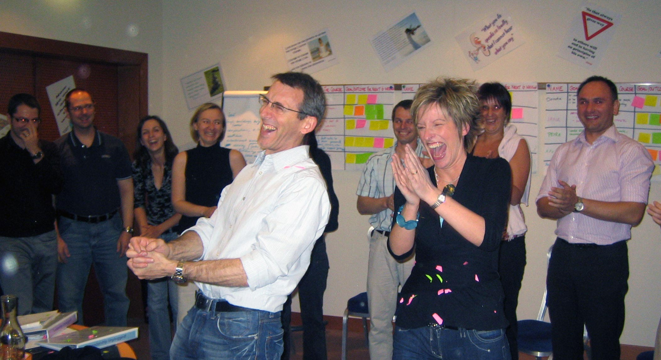 Alastair Olby being showered with homemade confetti by participant on a leadership programme