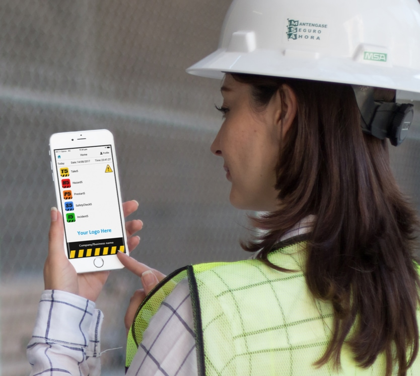 Female construction worker using app