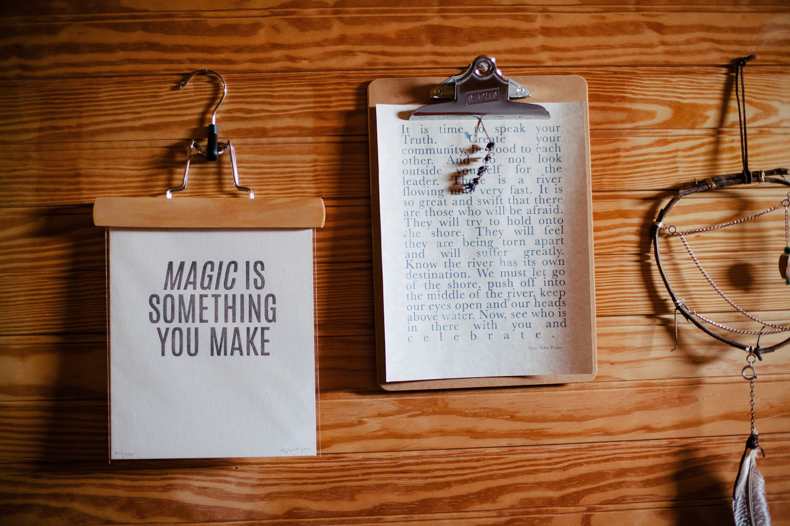 "CLipboard with the text ""Magic is something you make"" and dream catcher"