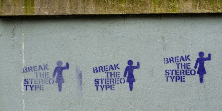 """Stamp saying """"break the stereotype"""" with a woman image"""