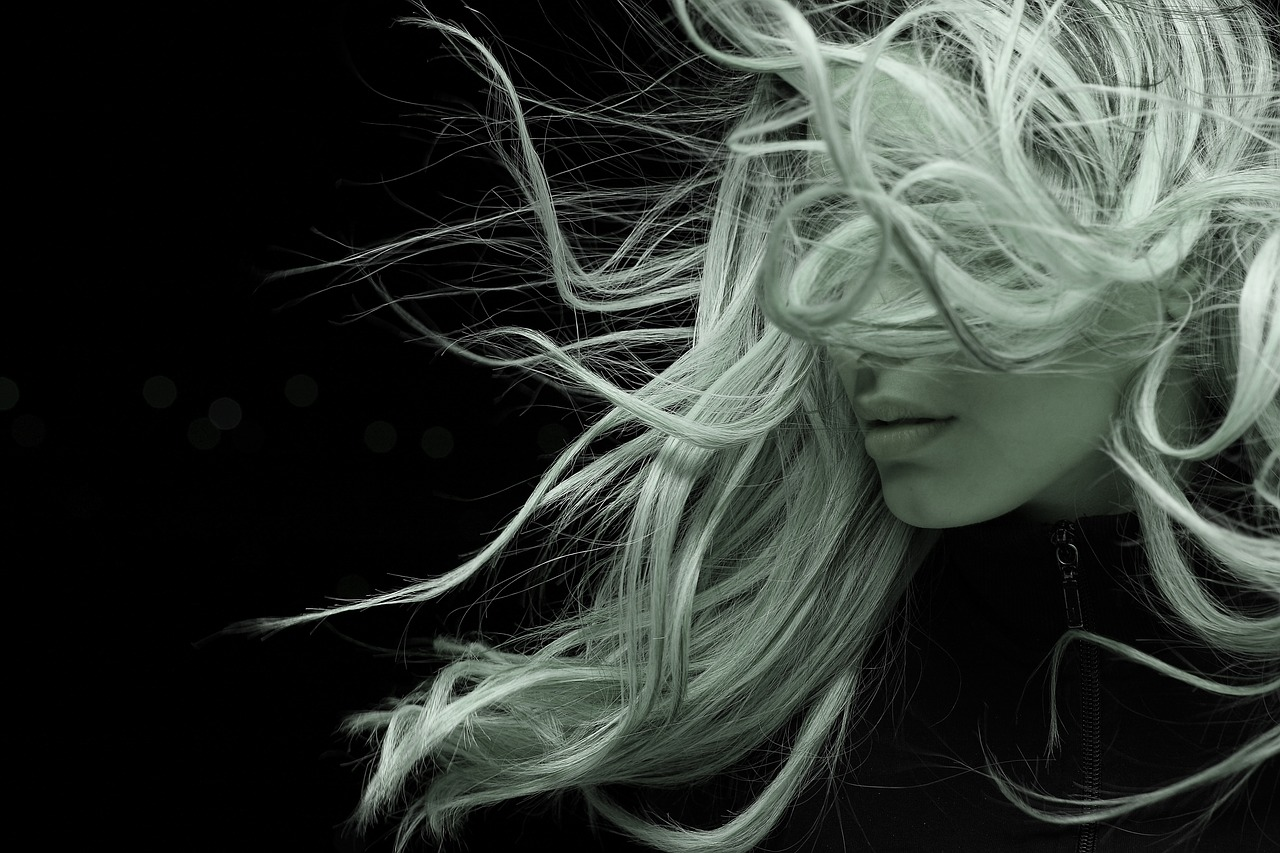 A women with a blonde hair in the wind