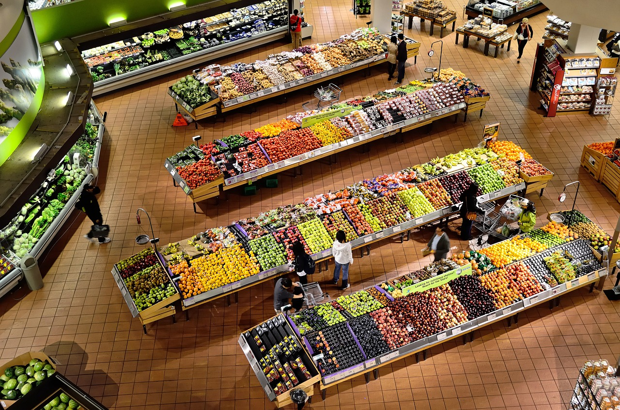 An overhead view of the produce department of a grocery store