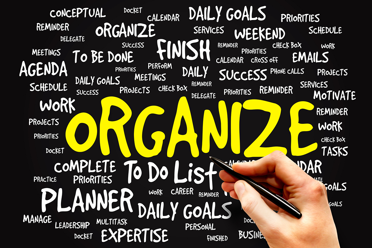 """Organize"" in yellow surrounded by white words with descriptive words of organization"